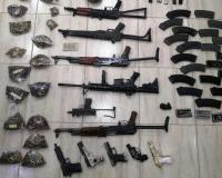 ضبط 11 سلاحاً نارياً بمداهمة منزل في عمان