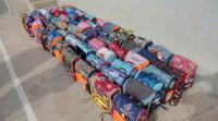 توزيع حقائب مدرسية في الأغوار