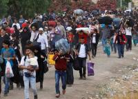 اجراءات لتسهيل عودة السوريين إلى بلادهم