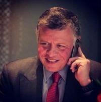 عباس يهاتف الملك