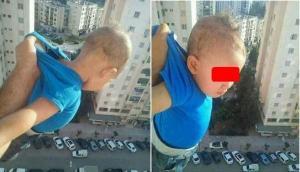 مشهد مرعب ..  رجل يخاطر بحياة طفل للحصول على صورة