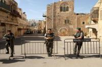 جرافات الاحتلال تهدم بناية ومنزلا