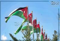 العايد: يحمل علمنا في طيّاته قصّة وطن راسخ